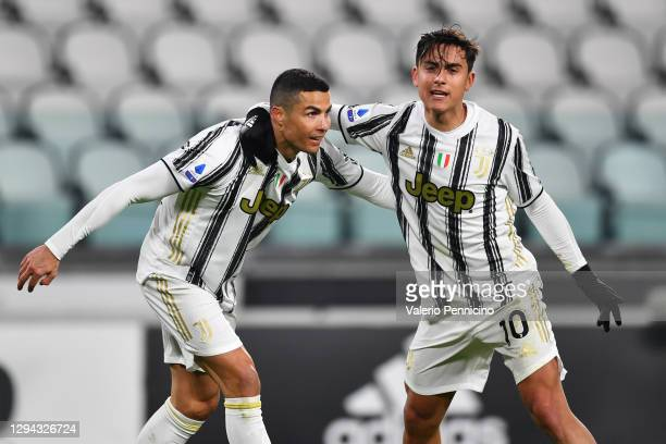Cristiano Ronaldo of Juventus F.C. Celebrates with teammate Paulo Dybala after scoring their team's first goal during the Serie A match between...