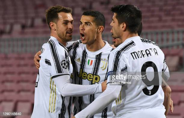 Cristiano Ronaldo of Juventus F.C. Celebrates with teammates Aaron Ramsey and after scoring their team's first goal during the UEFA Champions League...