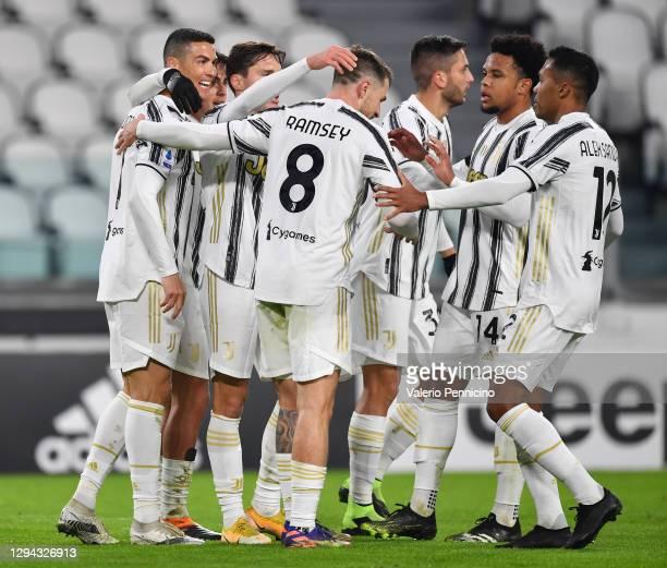 Cristiano Ronaldo of Juventus F.C. Celebrates with teammates Aaron Ramsey, Weston McKennie and Alex Sandro after scoring their team's first goal...