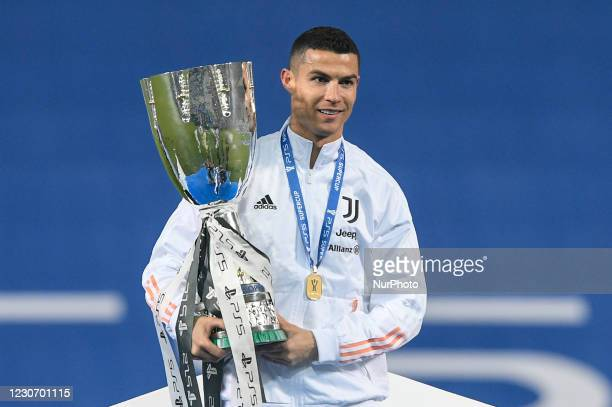Cristiano Ronaldo of Juventus FC celebrates with the trophy after winning the Italian Super Cup Final match between FC Juventus and SSC Napoli at the...