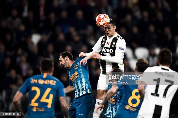 Cristiano Ronaldo of Juventus FC competes for a header with Juanfran of Atletico Madrid during UEFA Champions League Round of 16 second leg football...