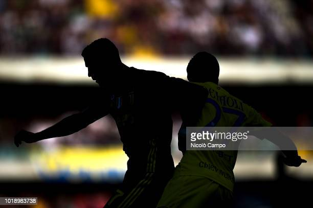 Cristiano Ronaldo of Juventus FC competes for the ball with Fabio Depaoli of AC ChievoVerona during the Serie A football match between AC...