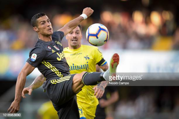 Cristiano Ronaldo of Juventus FC competes for the ball with Fabrizio Cacciatore of AC ChievoVerona during the Serie A football match between AC...