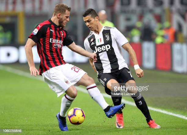 Cristiano Ronaldo of Juventus FC competes for the ball with Ignazio Abate of AC Milan during the Serie A match between AC Milan and Juventus at...