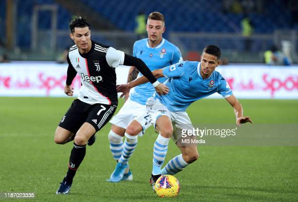 Cristiano Ronaldo of Juventus FC competes for the ball with Luiz Felipe and Sergej Milinkovi-Savi of SS Lazio during the Serie A match between SS...