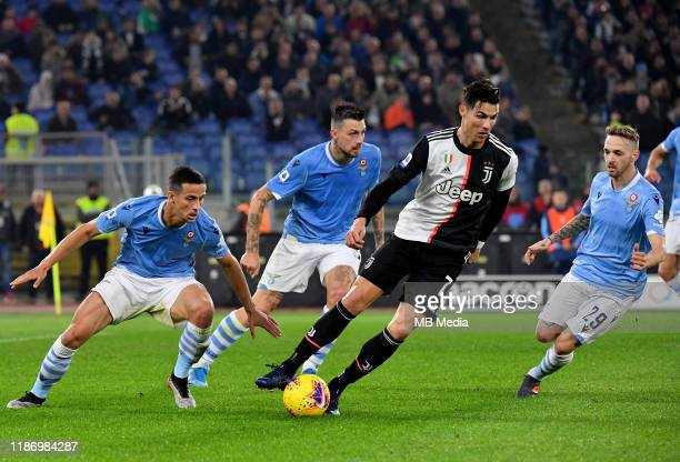 Cristiano Ronaldo of Juventus FC competes for the ball with Luiz Felipe ,Francesco Acerbi and Manuel Lazzari of SS Lazio during the Serie A match...