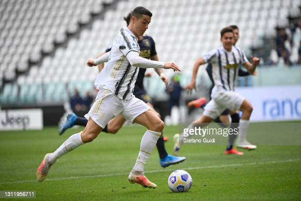 Cristiano Ronaldo of Juventus FC controls the ball during the Serie A match between Juventus and Genoa CFC at Allianz Stadium on April 11, 2021 in...