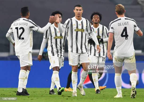 Cristiano Ronaldo of Juventus F.C. High fives team mate Alex Sandro of Juventus F.C. Whilst celebrating scoring their team's first goal during the...
