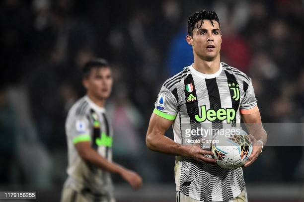 Cristiano Ronaldo of Juventus FC holds the ball as Paulo Dybala of Juventus FC looks at him prior to a penalty kick during the Serie A football match...