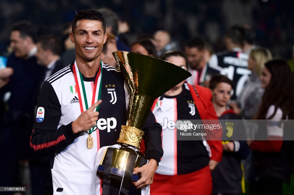 Cristiano Ronaldo of Juventus FC holds the trophy after... : News Photo