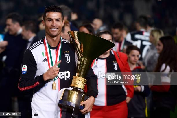 Cristiano Ronaldo of Juventus FC holds the trophy after winning the Serie A Championship 2018-2019 at the end of the Serie A football match between...