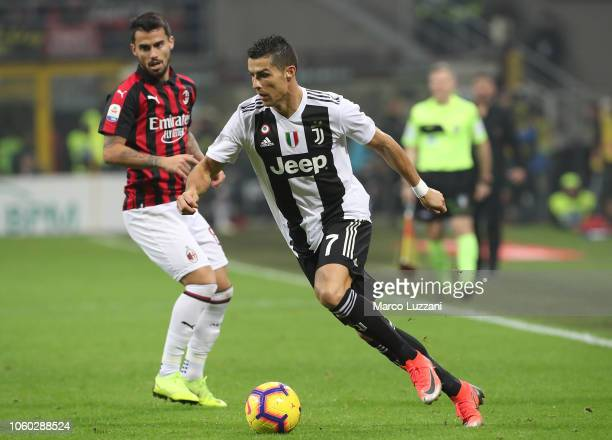 Cristiano Ronaldo of Juventus FC in action during the Serie A match between AC Milan and Juventus at Stadio Giuseppe Meazza on November 11 2018 in...