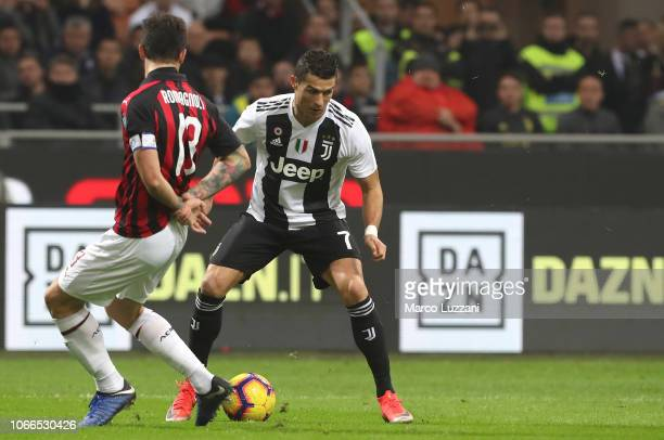 Cristiano Ronaldo of Juventus FC is challenged by Alessio Romagnoli of AC Milan during the Serie A match between AC Milan and Juventus at Stadio...