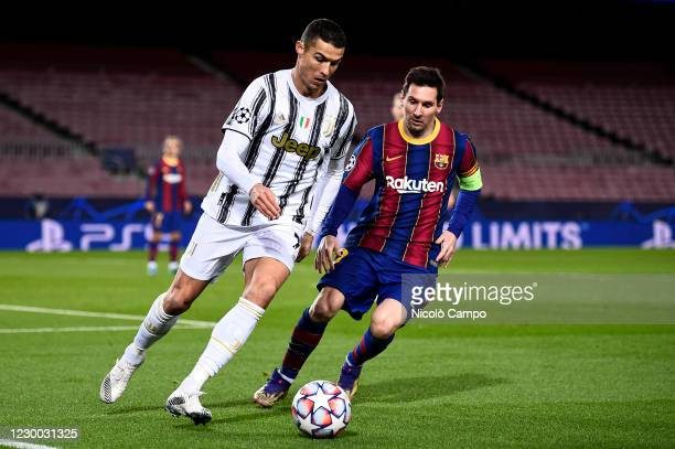 Cristiano Ronaldo of Juventus FC is challenged by Lionel Messi of FC Barcelona during the UEFA Champions League Group G football match between FC...