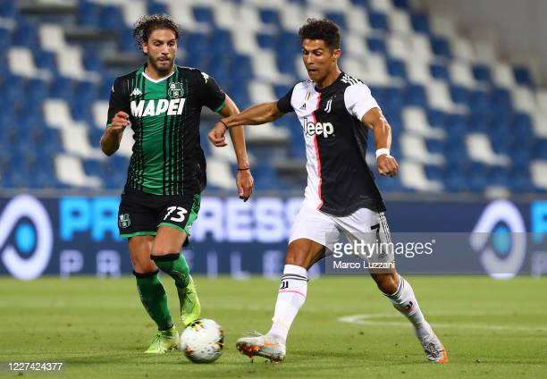 Cristiano Ronaldo of Juventus FC is challenged by Manuel Locatelli of US Sassuolo during the Serie A match between US Sassuolo and Juventus at Mapei...