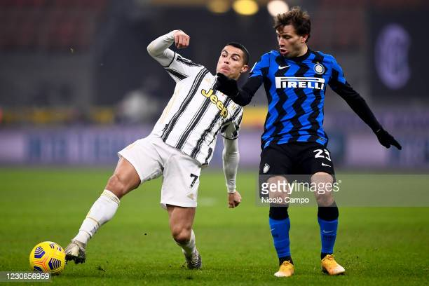 Cristiano Ronaldo of Juventus FC is challenged by Nicolo Barella of FC Internazionale during the Serie A football match between FC Internazionale and...