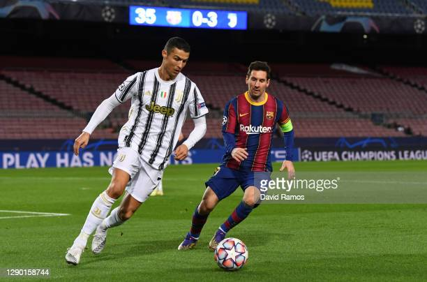 Cristiano Ronaldo of Juventus F.C. Is put under pressure by Lionel Messi of Barcelona during the UEFA Champions League Group G stage match between FC...