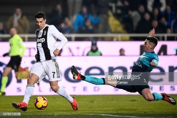 Cristiano Ronaldo of Juventus FC is tackled by Robin Gosens of Atalanta BC during the Serie A football match between Atalanta BC and Juventus FC. The...