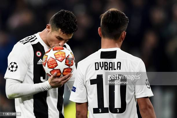 Cristiano Ronaldo of Juventus FC kisses the ball during UEFA Champions League Round of 16 second leg football match between Juventus FC and Club...