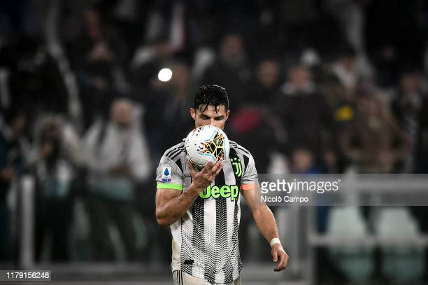 Cristiano Ronaldo of Juventus FC kisses the ball prior to a penalty kick during the Serie A football match between Juventus FC and Genoa CFC....