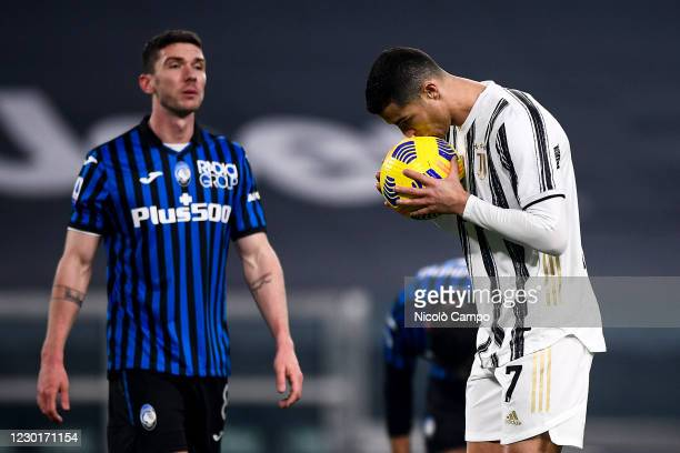 Cristiano Ronaldo of Juventus FC kisses the ball prior to a penalty kick during the Serie A football match between Juventus FC and Atalanta BC. The...