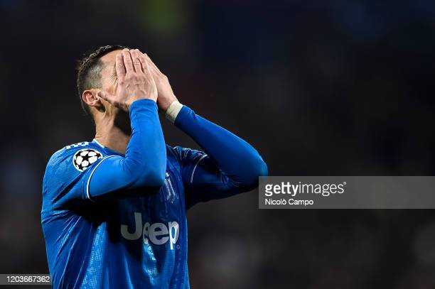 Cristiano Ronaldo of Juventus FC looks dejected during the UEFA Champions League round of 16 first leg football match between Olympique Lyonnais and...