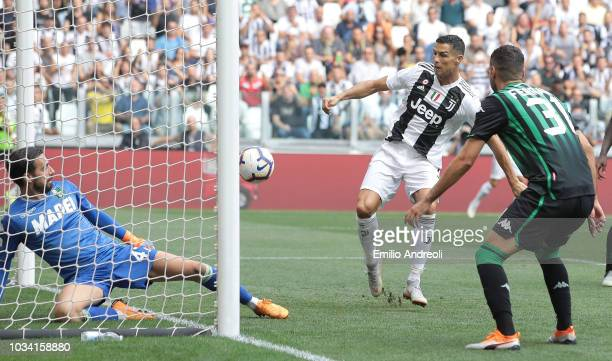 Cristiano Ronaldo of Juventus FC scores the opening goal during the serie A match between Juventus and US Sassuolo at Allianz Stadium on September 16...