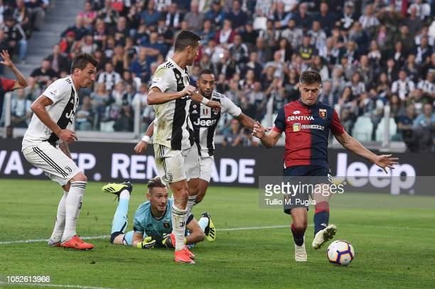 Cristiano Ronaldo of Juventus FC scores the opening goal during the Serie A match between Juventus and Genoa CFC at Allianz Stadium on October 20...