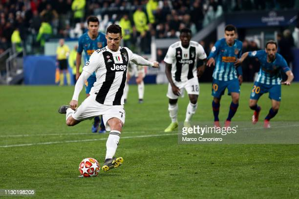 Cristiano Ronaldo of Juventus FC shoots a penalty to score 30 during the UEFA Champions League Round of 16 Second Leg match between Juventus Fc and...