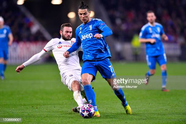 Cristiano Ronaldo of Juventus fights for the ball during the UEFA Champions League round of 16 first leg match between Olympique Lyon and Juventus at...