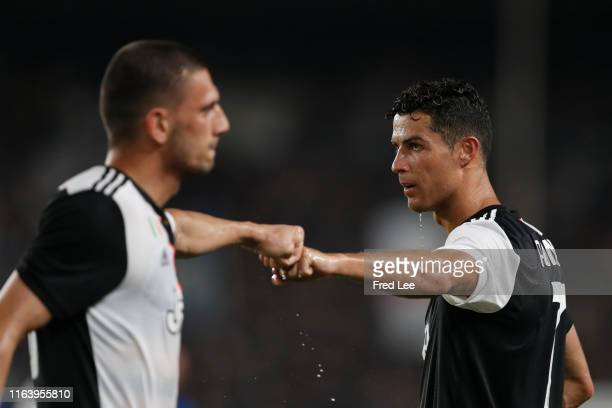 Cristiano Ronaldo of Juventus fist bumps with Merih Demiral during the International Champions Cup match between Juventus and FC Internazionale at...