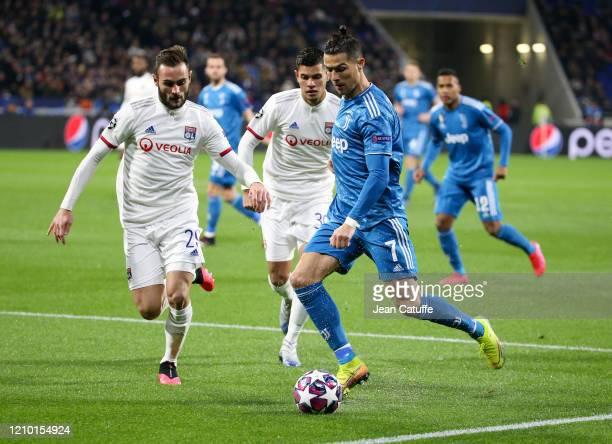 Cristiano Ronaldo of Juventus followed by Lucas Tousart, Bruno Guimaraes of Lyon during the UEFA Champions League round of 16 first leg match between...