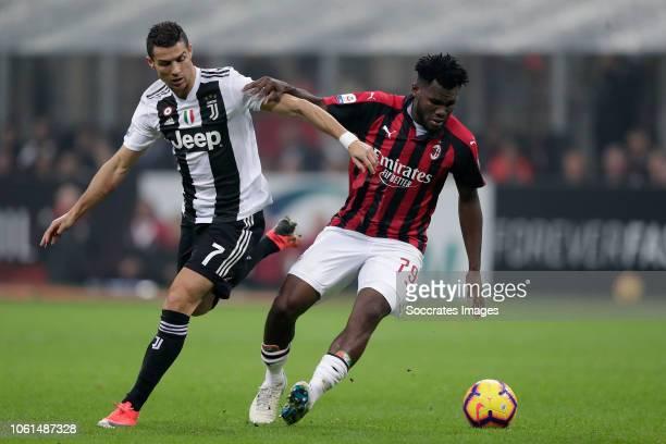 Cristiano Ronaldo of Juventus Franck Kessie of AC Milan during the Italian Serie A match between AC Milan v Juventus at the San Siro on November 11...