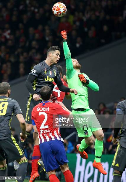 Cristiano Ronaldo of Juventus goalkeeper of Atletico Madrid Jan Oblak during the UEFA Champions League Round of 16 First Leg match between Club...