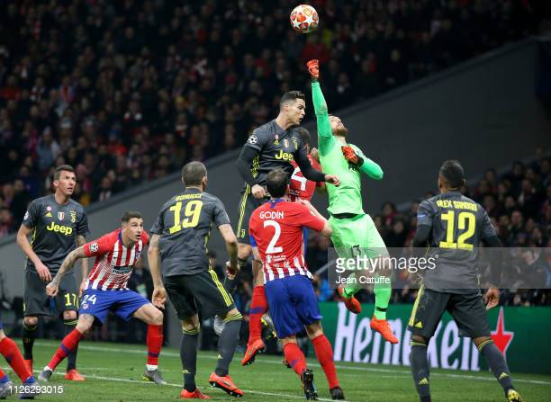Cristiano Ronaldo of Juventus, goalkeeper of Atletico Madrid Jan Oblak during the UEFA Champions League Round of 16 First Leg match between Club...