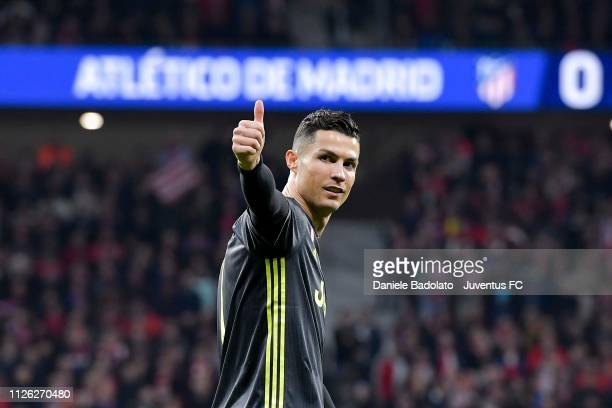 Cristiano Ronaldo of Juventus greets fans during the UEFA Champions League Round of 16 First Leg match between Club Atletico de Madrid and Juventus...