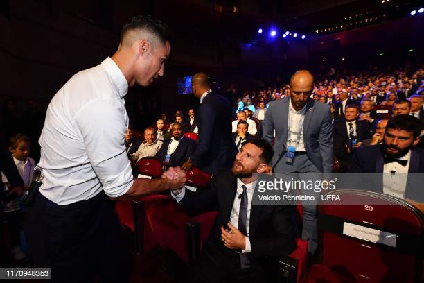 Cristiano Ronaldo of Juventus greets Lionel Messi of FC Barcelona during the UEFA Champions League Draw part of the UEFA European Club Football...