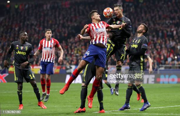 Cristiano Ronaldo of Juventus headers the ball during the UEFA Champions League Round of 16 First Leg match between Club Atletico de Madrid and...