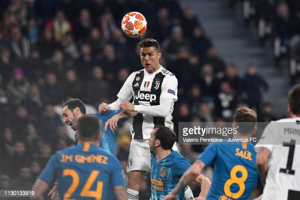 Cristiano Ronaldo of Juventus heads the ball during the UEFA Champions League Round of 16 Second Leg match between Juventus and Club de Atletico...