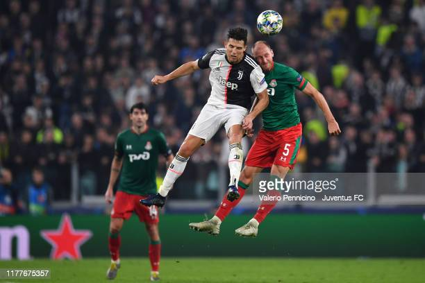Cristiano Ronaldo of Juventus heads the ball with Benedikt Howedes of Lokomotiv Moskva during the UEFA Champions League group D match between...