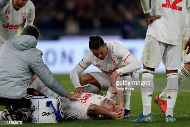 Cristiano Ronaldo of Juventus helps his teammate Merih Demiral during the Serie A match between AS Roma and Juventus at Stadio Olimpico on January 12...