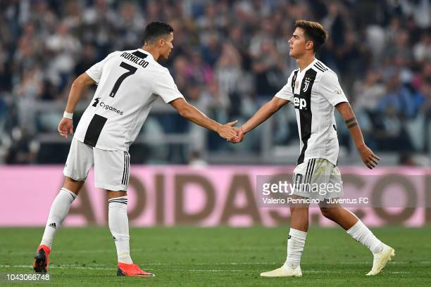 Cristiano Ronaldo of Juventus hifives Paulo Dybala during the Serie A match between Juventus and SSC Napoli at Allianz Stadium on September 29 2018...