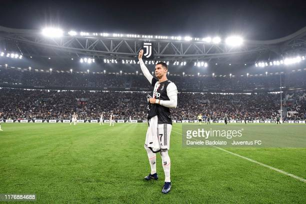 Cristiano Ronaldo of Juventus holds a jersey with the number 700 after being honoured for having scored 700 goals during his career before the Serie...