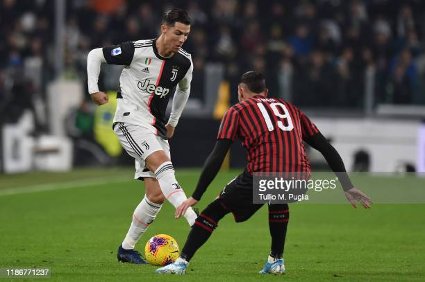 Cristiano Ronaldo of Juventus holds off the challenge from Hernandez Theo of Milan tackles during the Serie A match between Juventus and AC Milan at...