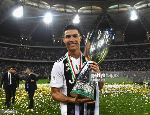 Cristiano Ronaldo of Juventus holds the Italian supercup trophy after the Italian Supercup match between Juventus and AC Milan at King Abdullah...