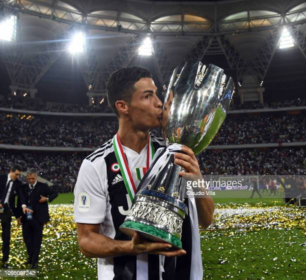 Cristiano Ronaldo of Juventus holds the Italian supercup trophy after winning the Italian Supercup match between Juventus and AC Milan at King...