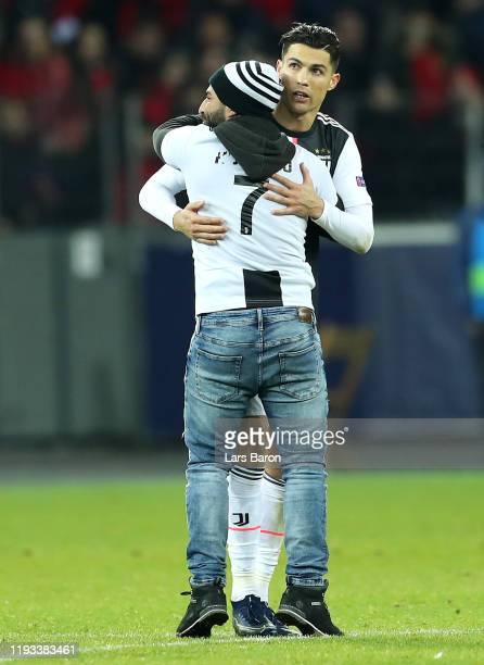 Cristiano Ronaldo of Juventus hugs a pitch invader during the UEFA Champions League group D match between Bayer Leverkusen and Juventus at BayArena...