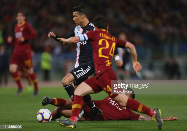 Cristiano Ronaldo of Juventus in action against AS Roma players during the Serie A match between AS Roma and Juventus at Stadio Olimpico on May 12...