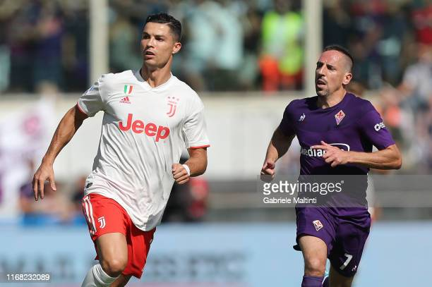 Cristiano Ronaldo of Juventus in action and Frank Ribery of ACF Fiorentina during the Serie A match between ACF Fiorentina and Juventus at Stadio...