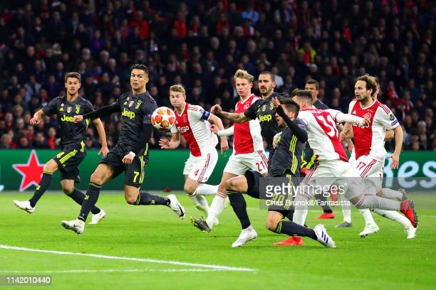 Cristiano Ronaldo of Juventus in action in a crowded penalty area during the UEFA Champions League Quarter Final first leg match between Ajax and...